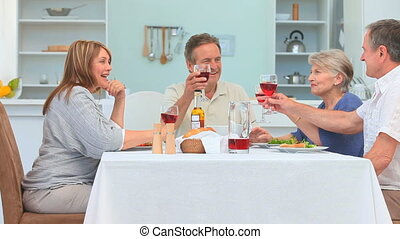 A dinner between mature friends in the dinning room
