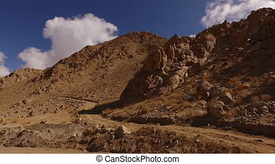A dirt track leading up a mountain in the desert - Dolly...