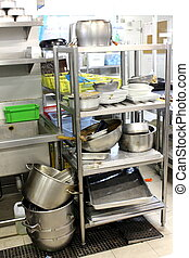 Dirty dishes waiting to be washed in kitchen