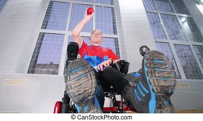 A disabled man in a wheelchair enjoying playing boccia. Low...