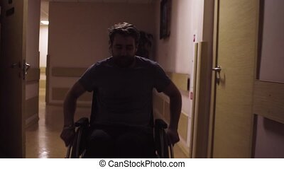 A disabled man in a wheelchair in the rehabilitation center...
