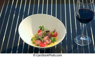 A dish of a gourmet restaurant. Close-up. Pork with...