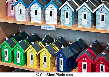 A display of plastic beach hut money boxes