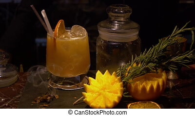 A display with herbs, fruit and a drink - A steady, close up...