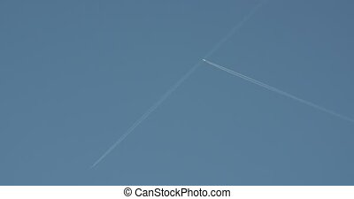 A distant airplane passes high overhead.