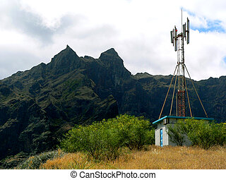 Distant Cell Tower - A Distant Cell Tower Sits Atop a Remote...