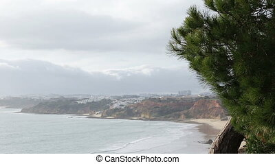 A distant view of the city Olhos de Agua from the beach...