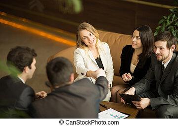 business team handshake at office