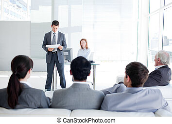 A diverse business people at a conference in an office