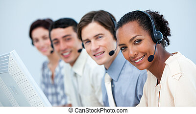 A diverse business team working in a call center