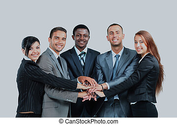 A diverse group of business workers with their hands together in form of teamwork.
