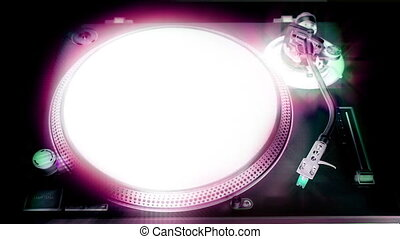 a dj's hand puts a vinyl on a turntable