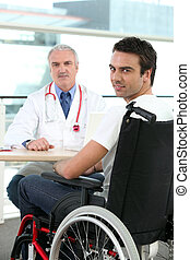 a doctor and a patient in wheelchair