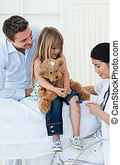 A doctor checking child\'s