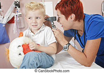 A Doctor Examining cute little boy