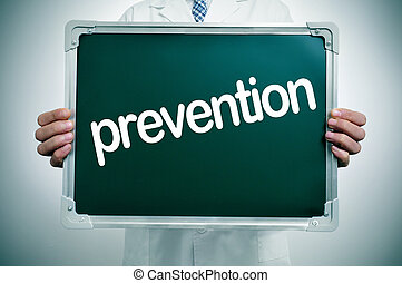 prevention - a doctor in white coat showing a chalkboard...