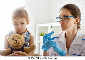 a vaccination to a child - A doctor makes a vaccination to a...