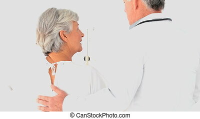 A doctor talking to a patient