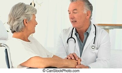 A doctor visting a patient