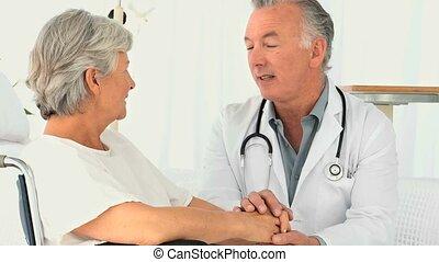 A doctor visting a patient