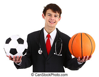 A doctor with a football and a basketball