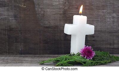 Burning Crucifix Candle - A dolly shot of a Burning Crucifix...