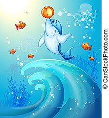 A dolphin playing a ball under the sea