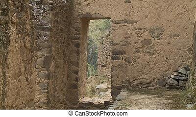 A door in an old house - A still medium shot of a doorway of...