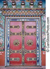 A Door of temple near Boudhanath buddhist stupa in Kathmandu capital of Nepal