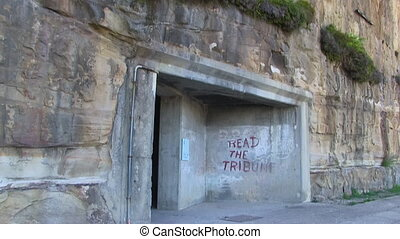 A door that leads to a tunnel - A medium shot of a door that...