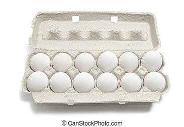 A Dozen Eggs - A dozen eggs in a carton isolated on white...