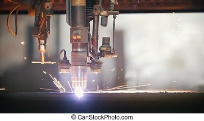 A drill of a milling machine processes a metal surface