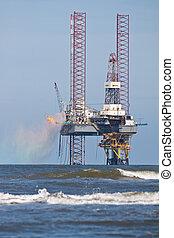 A drilling platform in the ocean - A drilling platform for...