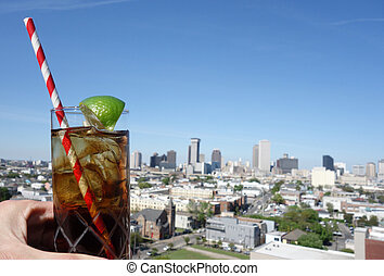 A drink and New Orleans skyline