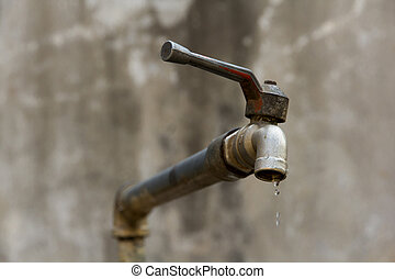 dripping tap - a dripping tap showing water being wasted
