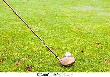 A driver club and a golf ball