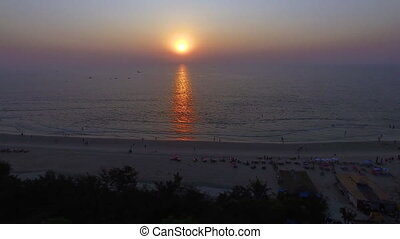 A drone shot captures the sunset by the beach - An aerial...