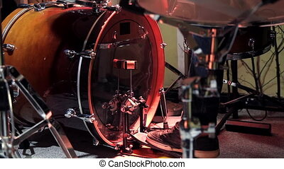 A drummer is drumming in the Studio. Plays the kick drum ...