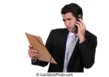 A dubious businessman over the phone.