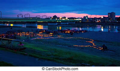 A dusk timelapse of burning romantic candles at the park wide shot panning