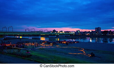 A dusk timelapse of burning romantic candles at the park wide shot tilt