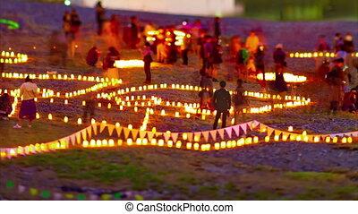 A dusk timelapse of burning romantic candles medium shot tiltshift
