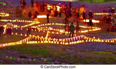 A dusk timelapse of burning romantic candles medium shot tiltshift tilting