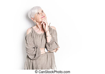 elderly woman on studio white background
