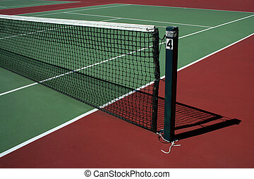 A empty green Tennis Court with net