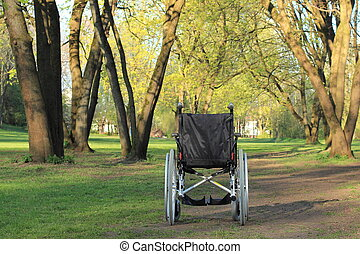 Empty wheelchair in a park