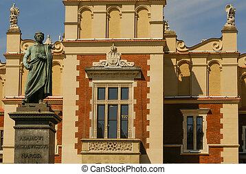a, estátua, de, adão, mickiewicz, frente, a, pano, corredor, em, krakow, em, polônia