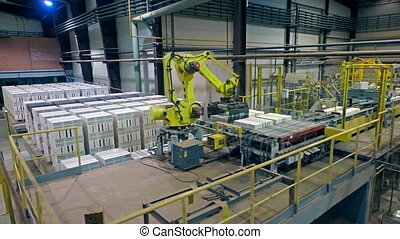 A factory for brick production. Shooting from a drone flying...