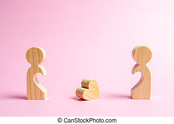 A fallen heart lies between two former lovers. The concept of separation or divorce. Reunion and restoration of love relationships. Search for a love partner or loved one. Dating on Valentine's Day.