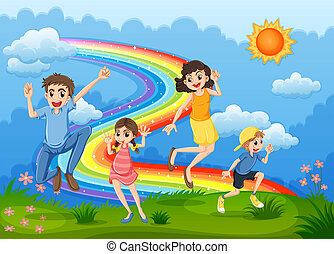 A family at the hilltop playing with the rainbow